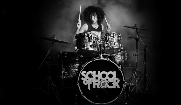 Student taking drum lessons at School of Rock
