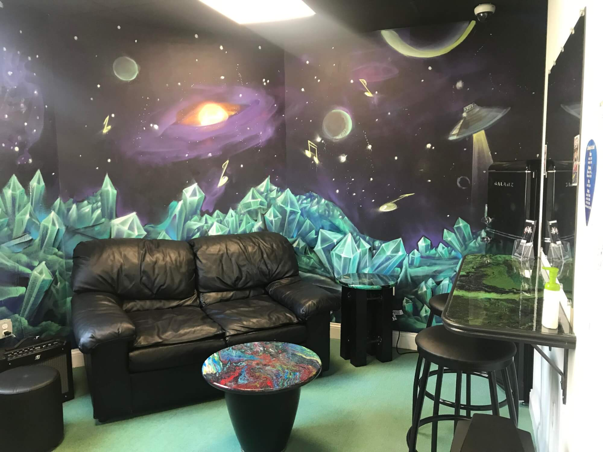 Our outer space green room/student lounge for practicing and pow wows is a great space.