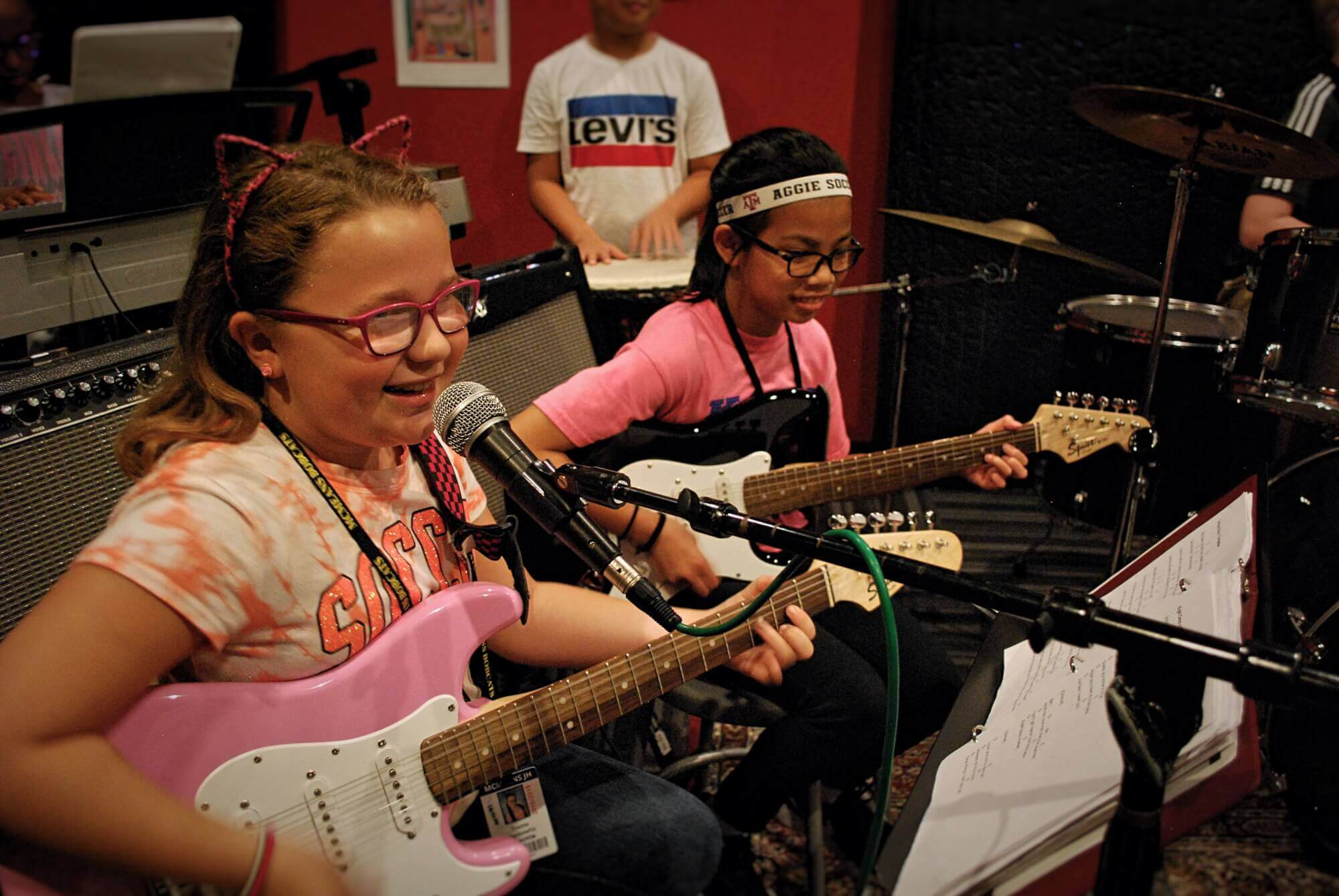 Rock 101 students enjoy working with their bandmates on their new songs.