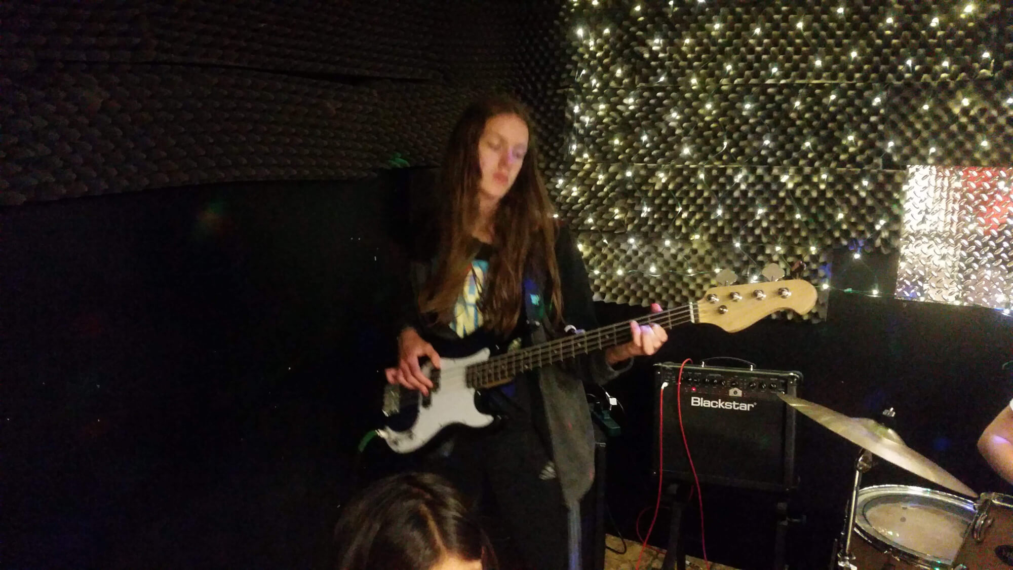 One of our students rehearses her bass part.