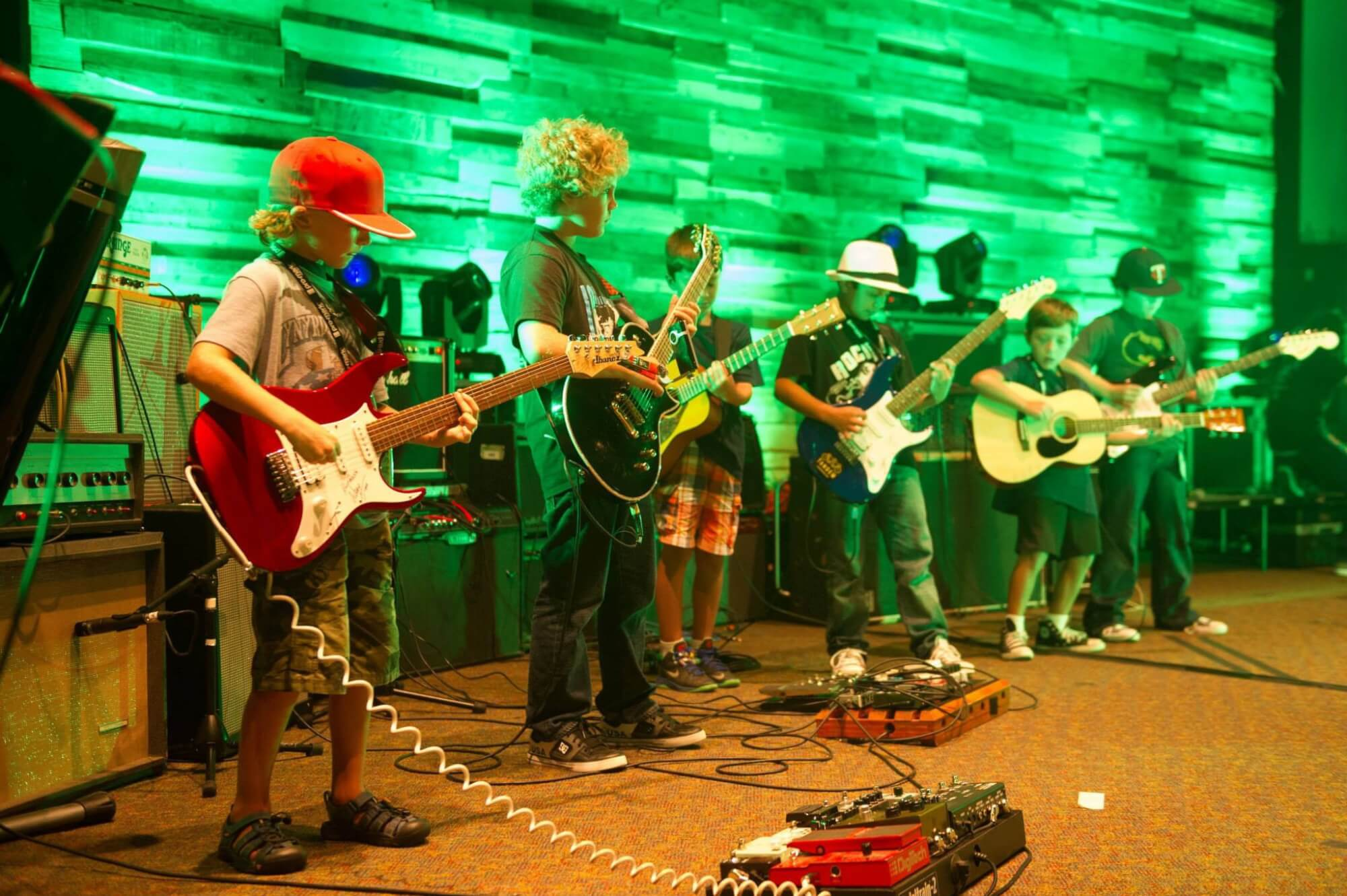 Guitar players perform at our Rock Camp finale.