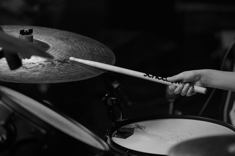 Picture of a School of Rock student hitting a cymbal with a drum stick