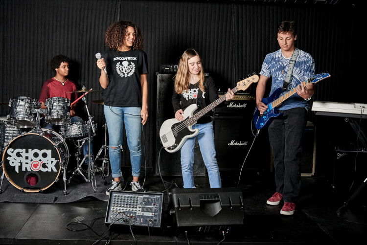 Students playing in the School of Rock House Band